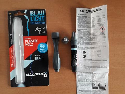 Zeigt alle Bestandteile des Blufixx Reparaturstifts inkl. Anleitung und Verpackung